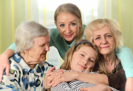 menopause: Four generations of women. Happy family.