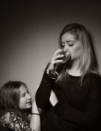 girl glasses: Child ask that mother stopped drinking alcohol.