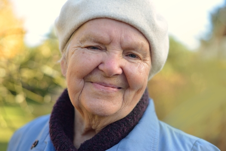 happy seniors: Senior happy woman smiling in garden.