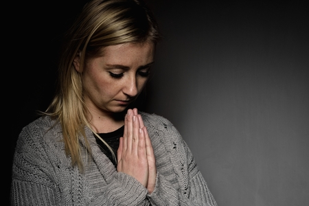 implore: Praying woman. Stock Photo