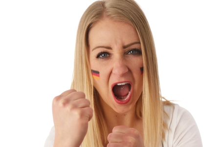 German soccer fan cheers football team in the national colors.