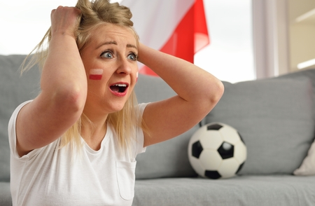 national colors: Polish fan cheers football team in the national colors.