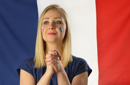 national colors: French soccer fan cheers football team in the national colors. Stock Photo