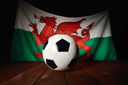 wood backgrounds: Flag of Wales with football on wooden boards as the background.