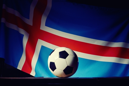 wood backgrounds: Flag of Iceland with football on wooden boards as the background. Stock Photo