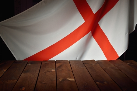 europe flag: Flag of the England with wooden boards as a background. Stock Photo