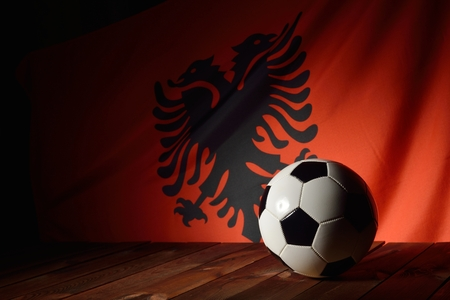 wood backgrounds: Flag of Albania with football on wooden boards as the background.