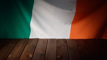 irish background: Flag of the Ireland with wooden boards as a background. Stock Photo