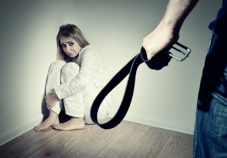 Woman afraid of her husband, who wants to beat her. Domestic violence. Imagens