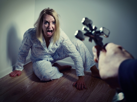 Casting out a demon from a woman through prayer. Exorcisms over deranged and crazy person. photo
