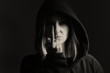 Mysterious woman in the hood shows sign of fuck off.
