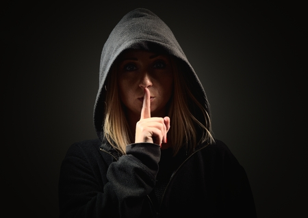 Mysterious woman in the hood requires silence.