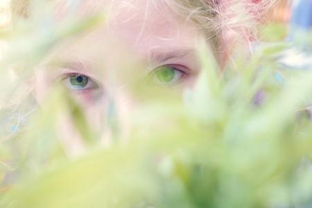 girls youth: Young girl in garden. Eyes in green.