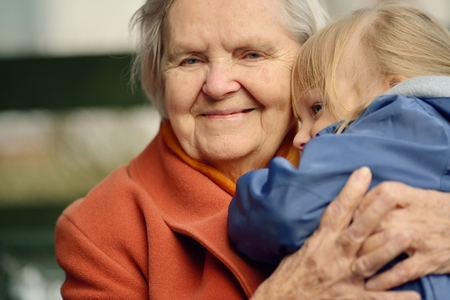 age: Grandmother and granddaughter. Happy family. Stock Photo