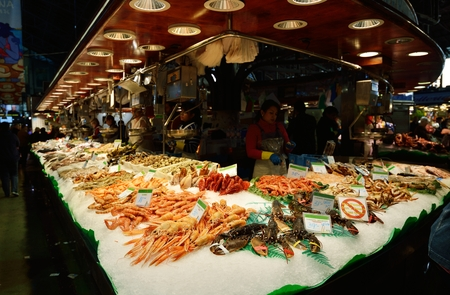 fish market: BARCELONA, SPAIN - NOVEMBER 11, 2016: The largest fresh food market in Barcelona. The first mention dates from 1217.
