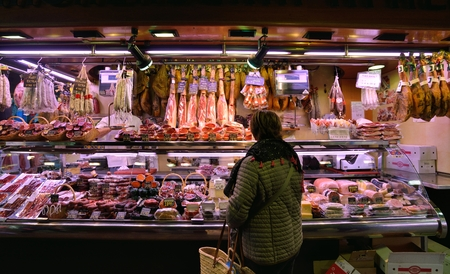 mention: BARCELONA, SPAIN - NOVEMBER 11, 2016: The largest fresh food market in Barcelona. The first mention dates from 1217.