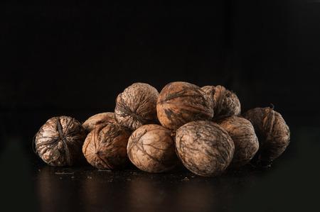 walnuts on a black background