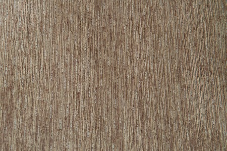 Background of tissue brownish yellow with vignetting. Striped