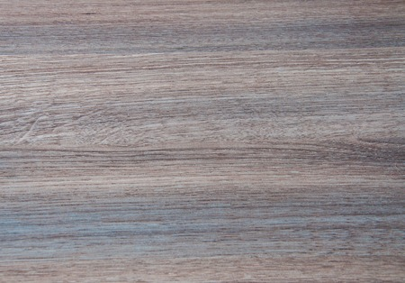 laminated: Wooden background of gray. striped, laminated