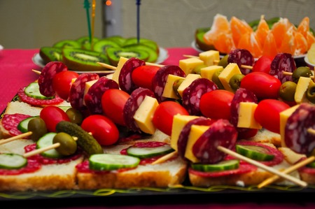 pretzel stick: snacks on a plate decorated with greenery