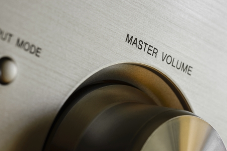 master volume: a close-up view of hi-fi system amplificator  It defines master volume knob close-up perspective  Stock Photo