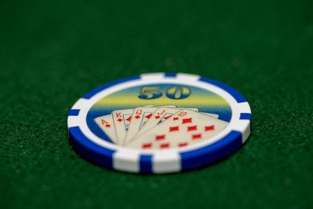 Poker chip on green felt
