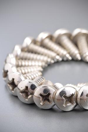 tightened: closeup of screw on the aluminium composite panel Stock Photo