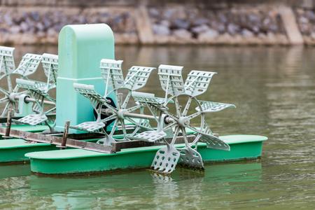 water turbine: Water turbine for increasing oxygen in pond Stock Photo