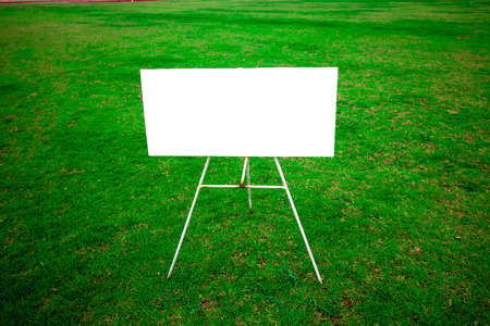 unmarked: board on the green grass Stock Photo