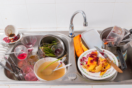 huge heap of dirty dishes Stock Photo