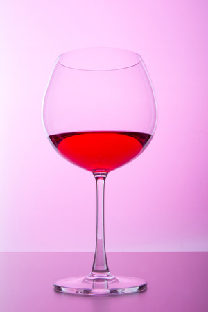 pellucid: glass with wine on pink background