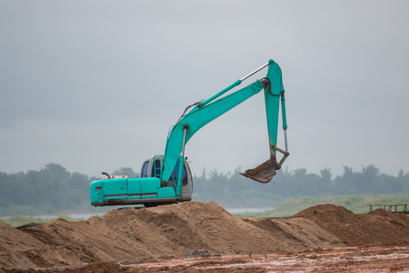 Excavator working in construction site Stock Photo