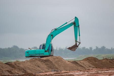 Excavator working in construction site Stock Photo