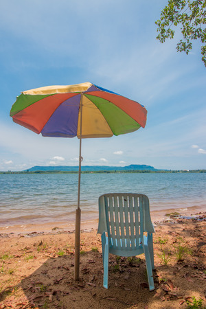 umbella: Relaxing on remote beach Stock Photo