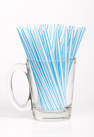 rainbow cocktail: Colored plastic drinking straws on a white background