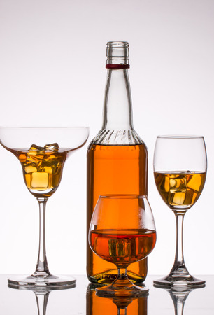 Red Wine bottle and glass on white background Stock Photo