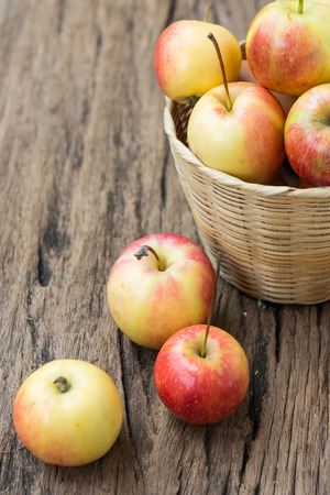 Apples and on brown wooden background Stock Photo