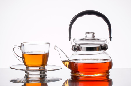 teapot and cup on white background