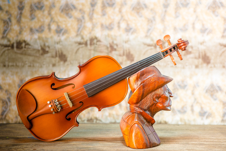 wooden figure: violin - still life with a wooden figure