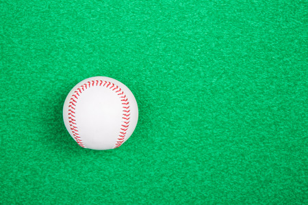 outfield: A white used baseball on the fresh green grass Stock Photo