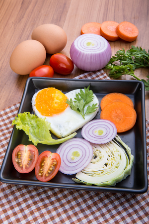 Eggs poached with vegetables on cloth background