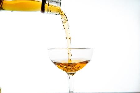 elegant  glass with splash of drink, amber colored liquid