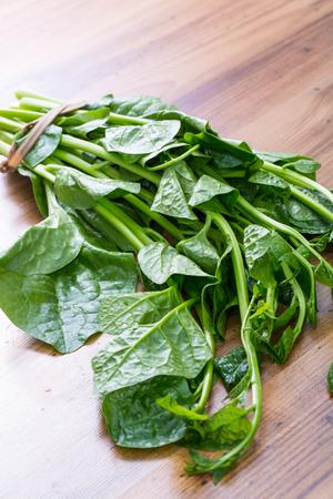 bard: Malabar spinach on cutting bard