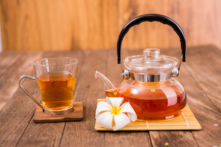 teapot: Teapot with  tea cup on wooden planks Stock Photo