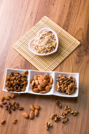 worktop: Mixed delicacies, walnut, currant, almond on wooden worktop