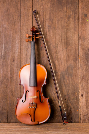 stradivarius: violin in vintage style on wood background