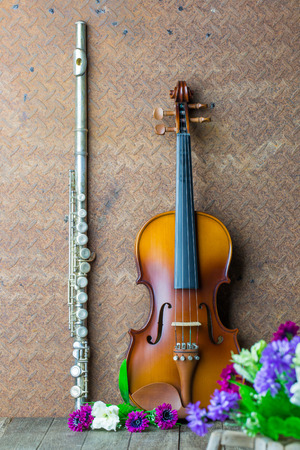 silver flute: Silver flute and violin on old steel background