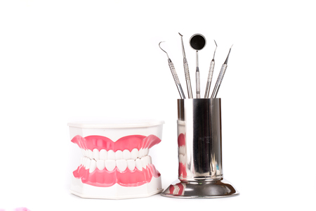 scratcher: metal medical equipment tools and dentel model Stock Photo