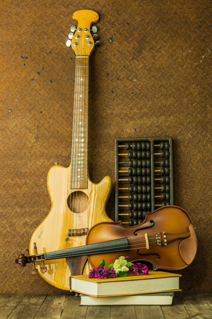 acoustic guitar and violin with old steel background
