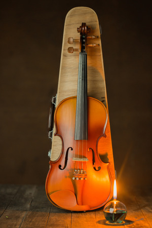 fingerboard: violin with lantern on old steel background,still life